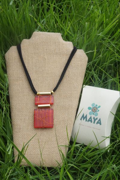 Red glass necklace copper fabric